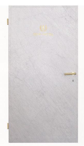 Michele Chiossi ONE HOTEL, 2006  marmo statuario, intarsio, foglia d'oro, ottone lucidato Alighiero Boetti tributo omaggio porta logo Kabul scultura maniglia serratura
