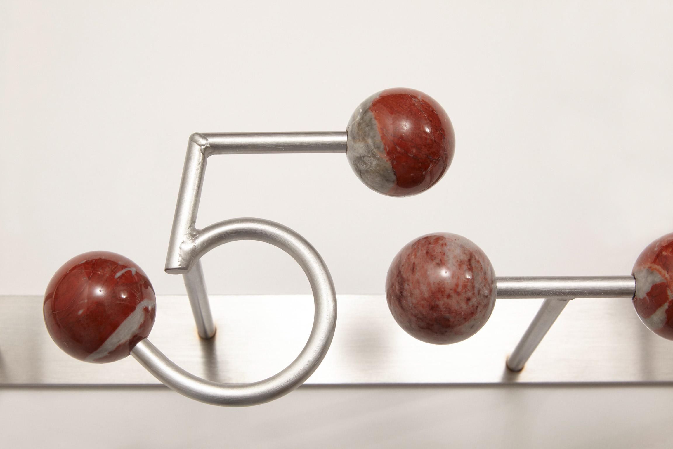 15-LOVE (det), 2017 marmo rosso Francia Languedoc Classico, acciaio  95x18x16 cm macchina da musica spartito musicale ombra scultura dot punto Eams