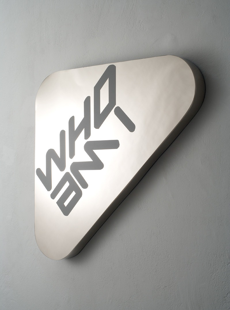 Michele Chiossi WHO AM I. (label), 2006  PVC su ottone nickelato NEW MAN logo post production scultura